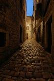 Empty evening or night european street with Cobblestones, in the light of a lantern. Rovinj, Croatia. Stock Image