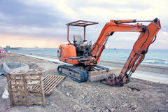 Empty excavator in front of Larnaca beach, Cyprus Stock Photo