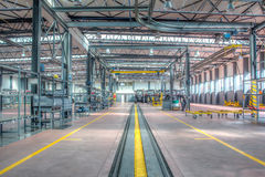Empty factory. Tractor assembly line.Tractor factory stock photos