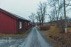 Empty Fagervik and the old red houses. Empty Fagervik on an autumn day with red old houses Royalty Free Stock Photo