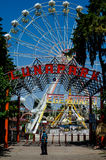 Empty fairground with Ferris wheel Stock Photos