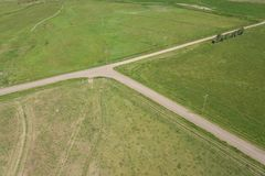 Empty Farm Dirt Road Intersection royalty free stock photography