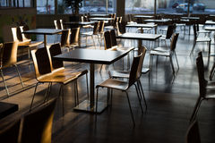 Empty fast-food restaurant lit by morning sun Stock Images