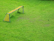 Empty Field. Singapore - August 2016 A stretch of green field with a goal pole at one corner royalty free stock images