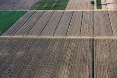 Empty fields in autumn. Aerial view harvested fields, Royalty Free Stock Images