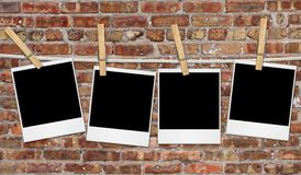 Empty Film Blanks Hanging Against a Grungy Brick W Royalty Free Stock Image