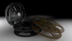 Empty film rollers - 3D rendering. Three empty film rollers on a white reflective surface, in a dark room - 3D rendering Stock Photo