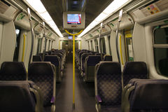 An empty first class carriage on the Hong Kong East Rail line MTR Train Stock Photo
