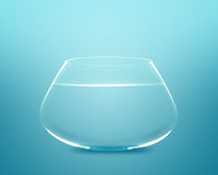Empty fishbowl. With water in front of blue background Royalty Free Stock Photos