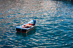 Empty fisher boat in ocean Royalty Free Stock Photo