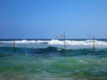Empty fishermen's sticks in Weligama bay, Sri Lanka Royalty Free Stock Images