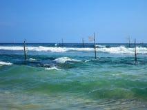 Empty fishermen's sticks in Weligama bay, Sri Lanka Stock Image