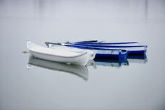 Empty fishing boats on a lake Stock Image