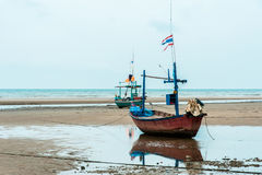Empty fishing boats. Fishing boats are empty. Parking on the white beach on monsoon day Royalty Free Stock Image