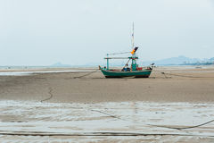 Empty fishing boats. Fishing boats are empty. Parking on the white beach on monsoon day Stock Image