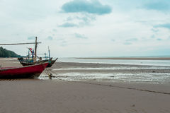 Empty fishing boats. Fishing boats are empty. Parking on the white beach on monsoon day Stock Photography
