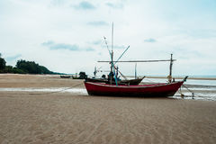 Empty fishing boats. Fishing boats are empty. Parking on the white beach on monsoon day Royalty Free Stock Photography
