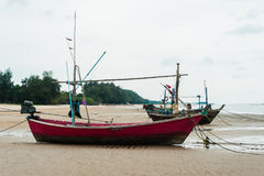 Empty fishing boats. Fishing boats are empty. Parking on the white beach on monsoon day Stock Images