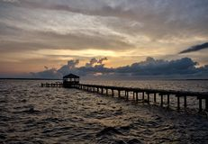 Fishing pier and dock at sunset Royalty Free Stock Photos