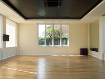 Empty fitness room with yoga mat. Empty fitness room with yoga mat television and garden view windows Stock Photo