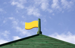 Empty flag on top of wooden fort roof Royalty Free Stock Image