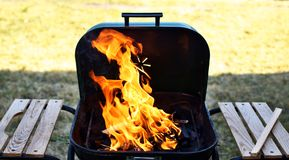 Empty flaming grill with open fire stock image