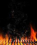 Empty flaming charcoal grill with open fire Royalty Free Stock Photography