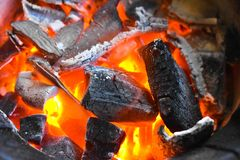 Empty flaming charcoal grill with open fire, ready for product placement. Concept of summer grilling, barbecue, bbq and party. royalty free stock photo