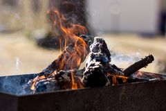 Empty flaming charcoal grill with open fire, ready for product placement Royalty Free Stock Images