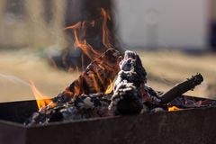 Empty flaming charcoal grill with open fire, ready for product placement stock image