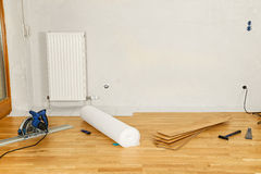 Empty flat with parquet flooring. And tools Royalty Free Stock Image