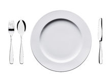 Empty flat plate with spoon, knife and fork isolated on white background. Stock Photography