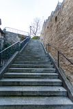Empty flight of exterior stairs alongside a wall Royalty Free Stock Photography