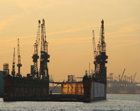 Empty floating dock. At sunset in the harbour of Hamburg, Germany. Amazing light Stock Image