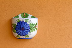 Empty flower pot on orange wall Stock Image