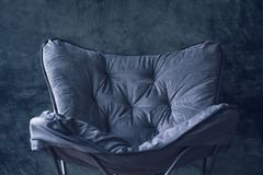Empty foldable chair against gray wall. As copy space Royalty Free Stock Image