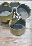 Empty food can on wooden board Royalty Free Stock Images