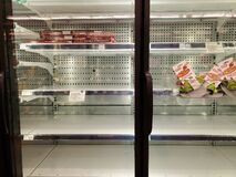 Empty Food Shelves At The Grocery Store Due To Hording After Coronavirus Scare Stock Photos