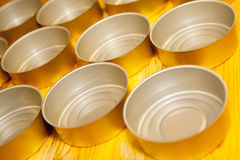 Empty food tins prepared for filling Stock Image