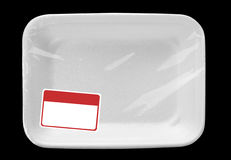 Empty food tray with label. Empty wrapped white food tray with blank label. Isolated on black Stock Photo