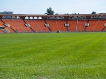 Empty football field. And stadium Stock Photos