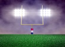 Empty Football Field and Spotlight with Smoke. Background Royalty Free Stock Photography