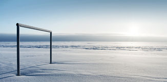 Empty football gate in winter. Empty football gate on the coast of the Gulf of Finland in winter Royalty Free Stock Photos