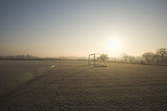 Empty football pitch and frosty winter morning Stock Photo