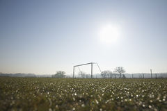 Empty football pitch and frosty winter morning Stock Image