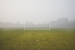 Empty football pitch and frosty winter morning Stock Photos