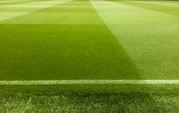 an empty football stadium with green grass royalty free stock photo