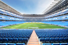 Empty Football Stadium With Seats, Rolled Gates And Lawn Royalty Free Stock Photos