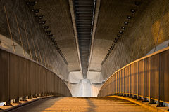 Empty footpath under the massive concrete bridge Royalty Free Stock Image