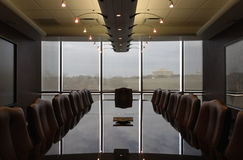 Empty formal boardroom contemporary design. A empty boardroom waiting for use - ready for action - decision making time - tipping point - Reflecting on the Royalty Free Stock Image